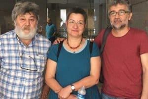 Şebnem Korur Fincancı, Erol Önderoğlu, and Ahmet Nesin posing after their court hearing