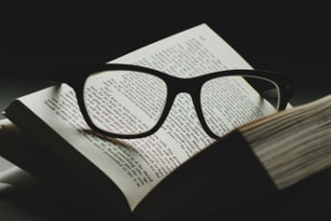 Open book with glasses on the page