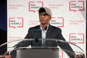 eskinder nega speaking at a podium