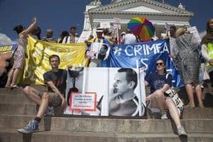 demonstrators holding Oleg Sentsov banners