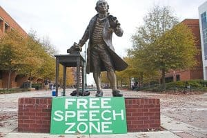 "statue with a sign that says ""Free Speech Zone"""