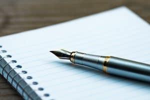 pen on a blank notebook