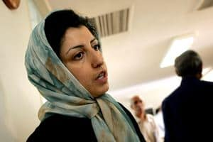 Narges Mohammadi talking to someone wearing a hijab