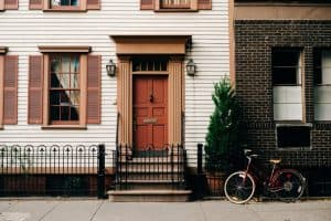 house with a stoop and bike out front