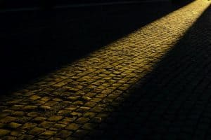 dark sidewalk with a ray of light