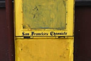 A decommissioned or defaced San Francisco Chronicle newspaper box painted yellow and abandoned in an alley in San Francisco, California. (Photo by Robert Alexander/Getty Images)