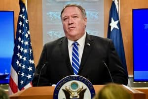 secretary of state mike pompeo stands behind lectern