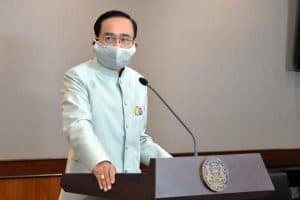 thai prime minister at a podium