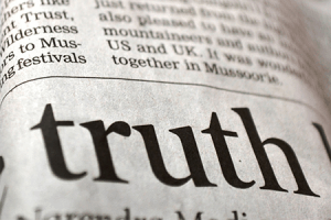"the word ""truth"" on a newspaper"