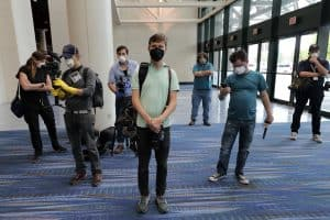 Journalists wearing personal protective equipment