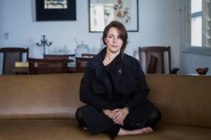 tania bruguera seated on couch