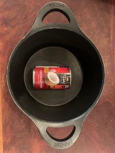 Can of coconut milk in a pot