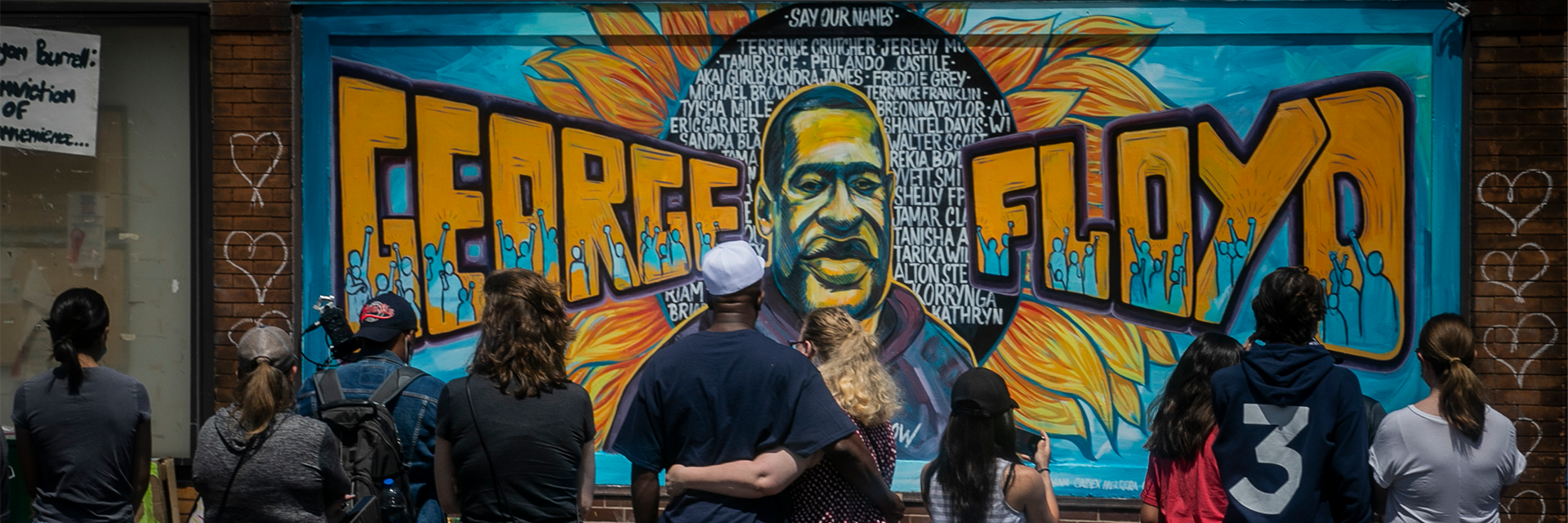 Visitors at memorial featuring a mural of George Floyd in Minneapolis, MN