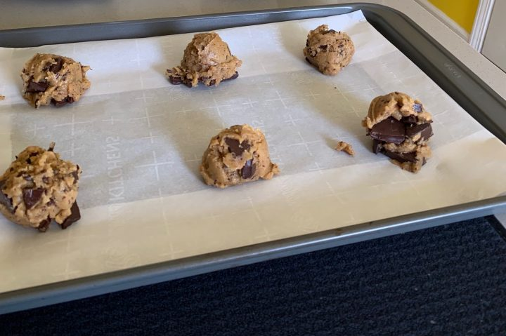 Shaped dough balls of chewy chocolate chunk cookies