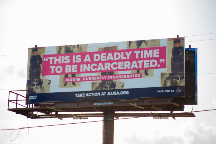 """This Is a Deadly Time to Be Incarcerated"" bilboard by JLUSA.ORG"