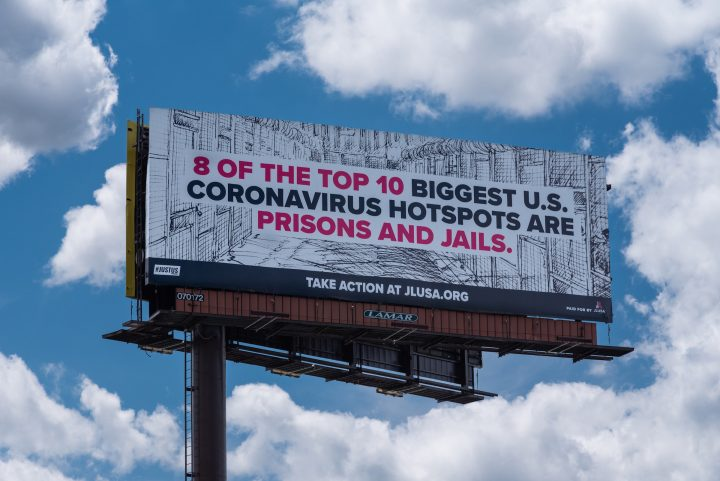 "Billboard that reads: ""8 of the top 10 biggest U.S. coronavirus hotspots are prisons and jails."""