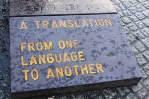 "Engraved stone that says ""A Translation From One Language to Another"""