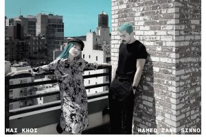 """""""Antibodies"""" album art: Mai Khoi posed against city landscape next to Hamed Sinno posed against a brick wall"""
