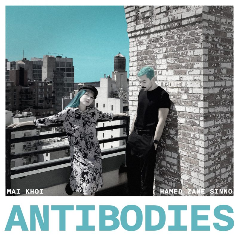 """Antibodies"" album art: Mai Khoi posed against city landscape next to Hamed Sinno posed against a brick wall"