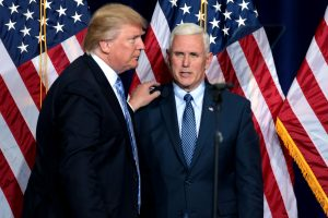 Donald Trump with one hand on Mike Pence's shoulder