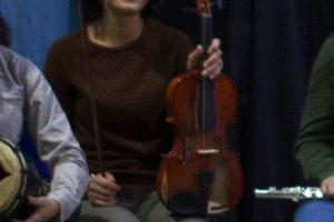 Emel Yeşilırmak seated with violin