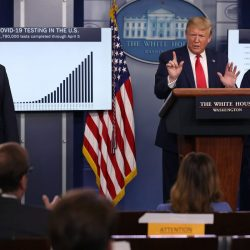 President Trump standing at the podium in the White House during an exchange with ABC's Jon Karl