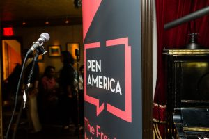 pen america banner and microphone