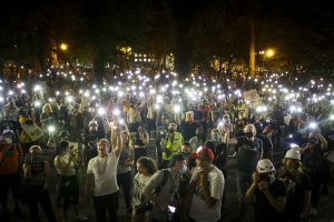 Demonstrators gathered at a Portland Black Lives Matter protest raising their cell phone lights