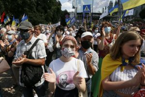 Supporters gathered in front of a court building in Ukraine, many of them clapping and wearing face masks