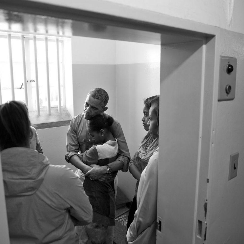 Barack Obama hugging daughter inside prison cell at Robben Island