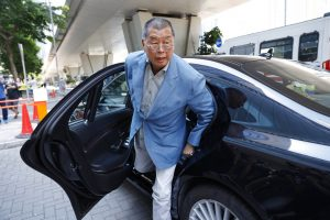 jimmy lai getting out of a car