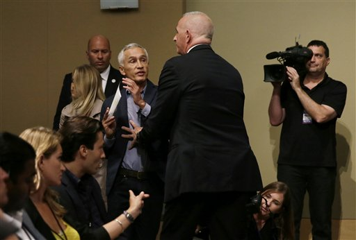 Jorge Ramos being escorted out by security