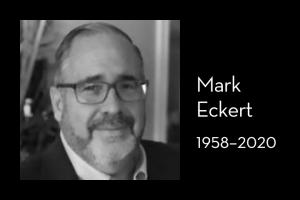 """Mark Eckert's headshot on left; on right: """"Mark Eckert, 1958–2020"""""""