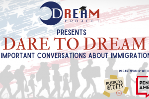 """In the background: a silhouette of migrants marching against a partially erased American flag; on top: """"Dream Project presents Dare to Dream: Important Conversations About Immigration in partnership with Busboys and Poets and PEN America"""""""