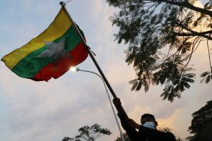 Protester waving a Myanmar flag