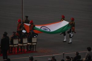 Soldiers folding the Indian flag