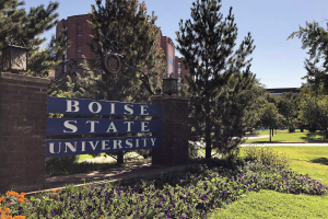 sign that reads Boise State University amid bushes and trees