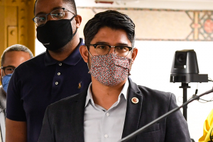 Carlos Menchaca, masked, at the 59th Street Station in New York City