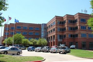 image of buildings surrounding a roadway at collin college in texas