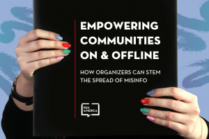 "Two hands holding a black board with text that reads ""Empowering Communities On & Offline: How Organizers Can Stem the Spread of Misinfo"""