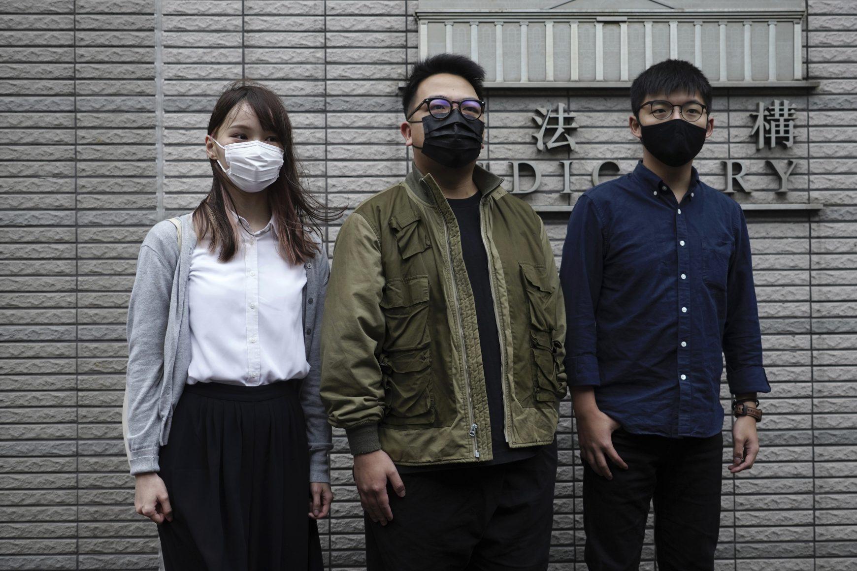 Hong Kong activists Joshua Wong, Ivan Lam and Agnes Chow arrive at a court in Hong Kong