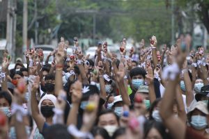 large group of protesters raising sign of resistance in Yangon, Myanmar