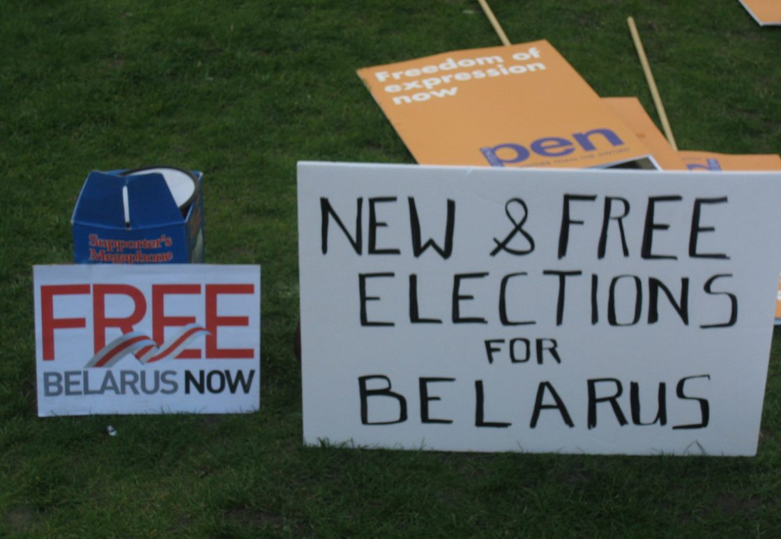 """protest sign reading """"new and free elections for Belarus"""""""