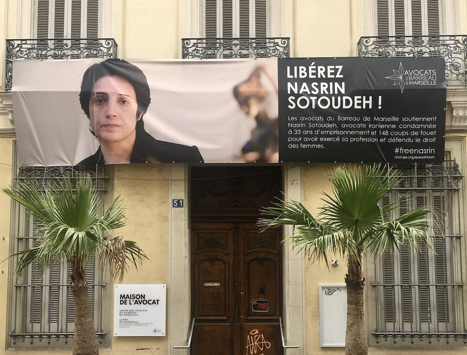 A poster in support of Iranian women's rights activist Nasrin Sotoudeh and demanding her release hangs on a building in Marseille, France
