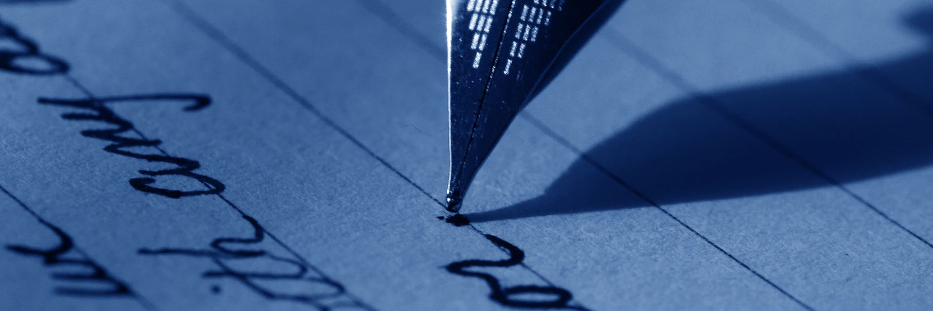 a fountain pen writes on a piece of paper