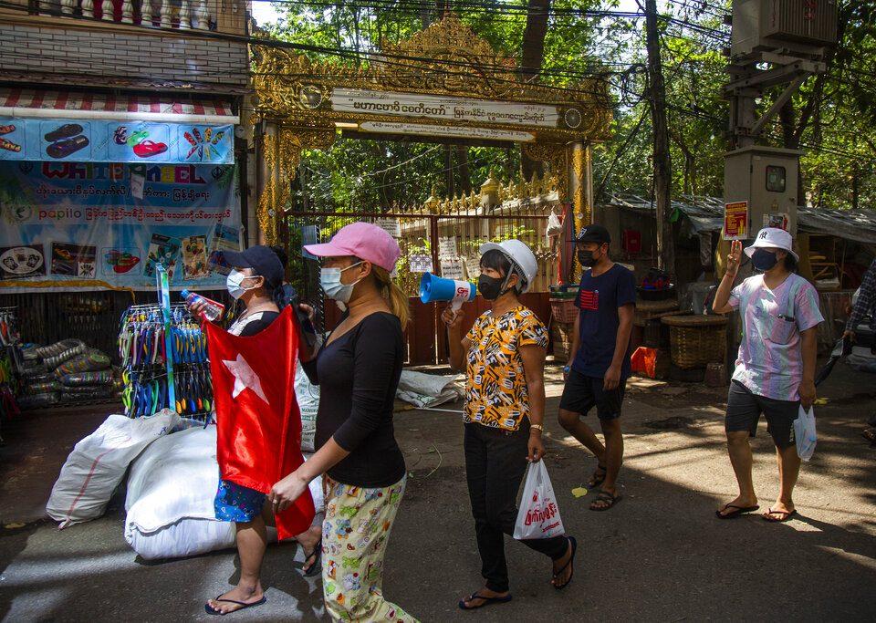 marchers in the street in Myanmar