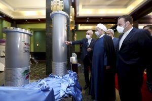 Iran's president and others stand inside nuclear facility