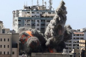smoke billows from a building in Gaza