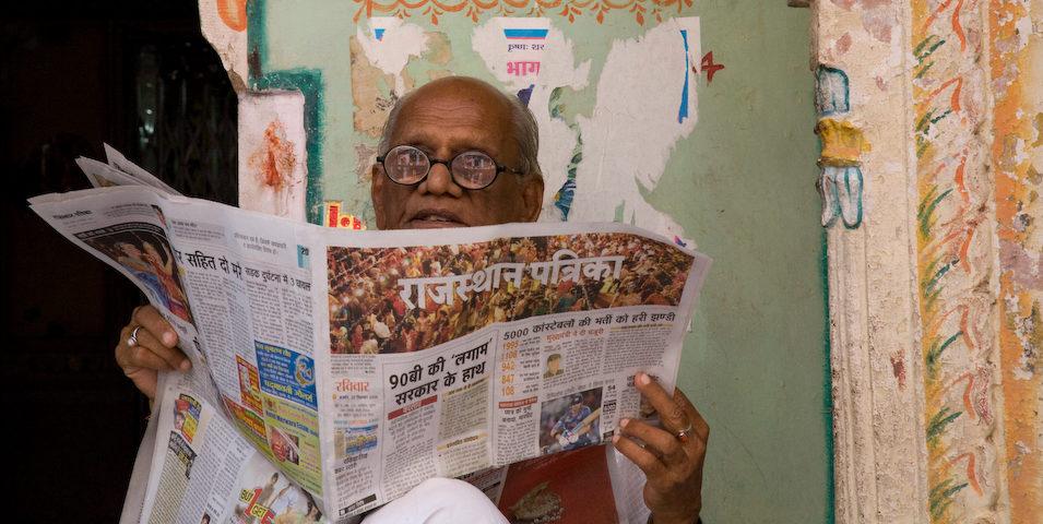 Man reading a Rajasthan newspaper about internet shutdowns in Jammu and Kashmir