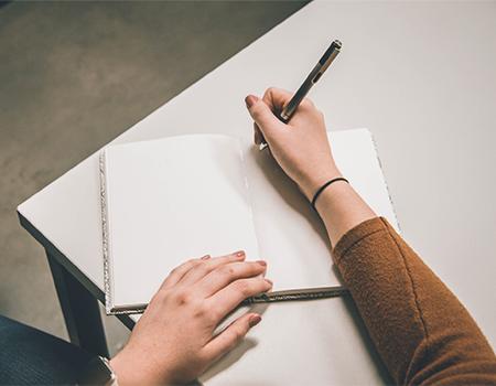 Notebook Pen Writing On Table Unsplash
